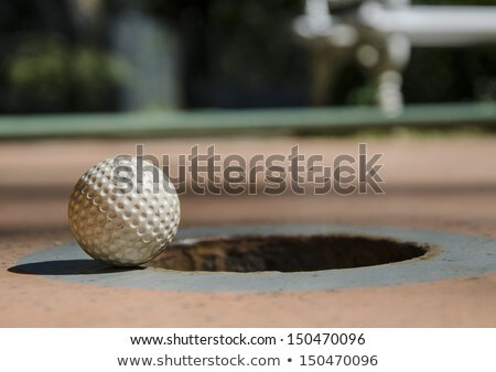 Golf ball just missed hole. Stock photo © lichtmeister