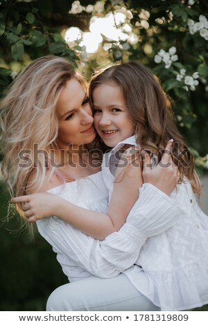 Charming girl with mother setting her hair Stock photo © vkstudio