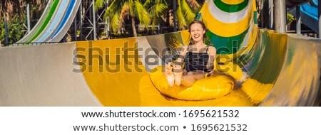 Happy woman going down a water slide BANNER, LONG FORMAT Stock photo © galitskaya
