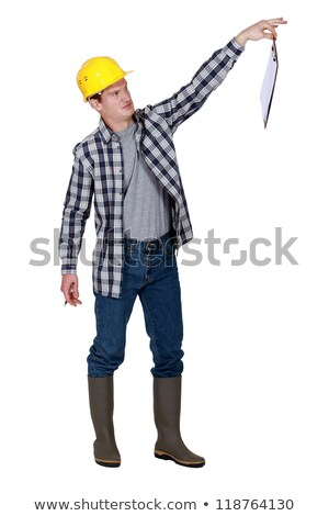 A repulsed tradesman dangling a clipboard Stock photo © photography33