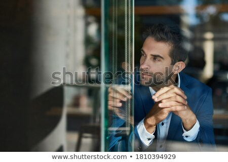 Businessman looking through his office window Stock photo © photography33