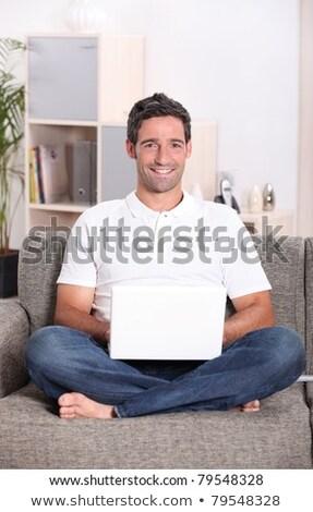 Man sat on sofa Stock photo © photography33