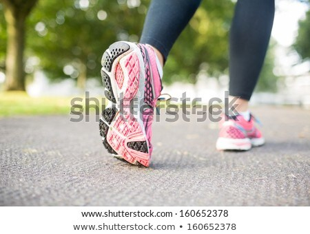 Sneakers soles on grass Stock photo © anmalkov