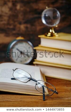 Livro aberto óculos isolado branco escritório papel Foto stock © chris2766