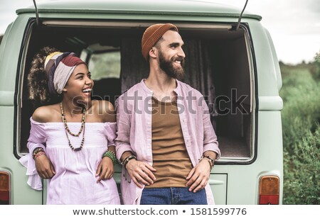 Portrait of cheerful young man leaning on van Stock photo © wavebreak_media