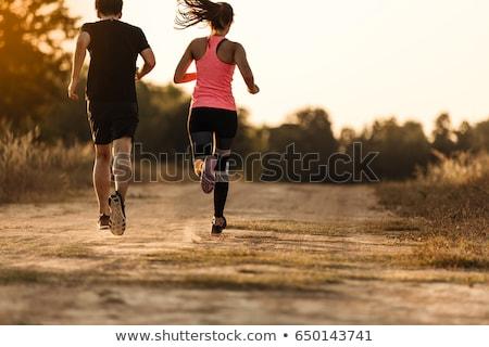 Urban jogging - couple running in autumn city Stock photo © Kzenon