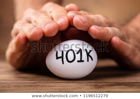 Man Protecting 401k White Egg Stock photo © AndreyPopov
