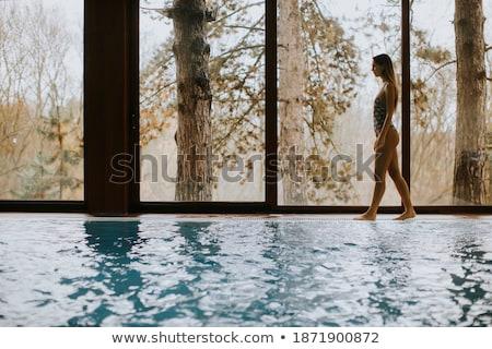 güzel · genç · kadın · ayakta · yüzme · havuzu · bornoz · su - stok fotoğraf © boggy