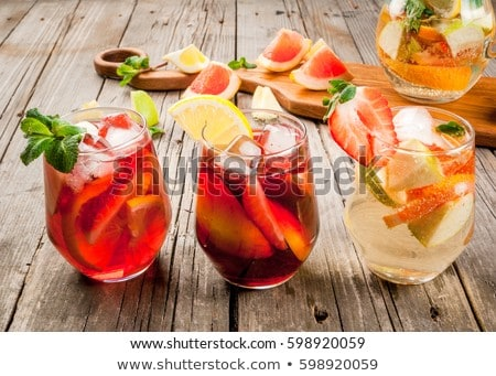 Glass of iced sangria with strawberry, orange, apple and lemon i Stock photo © dashapetrenko