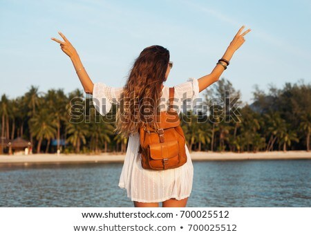Young woman spreading arms and enjoying backpacking travel in th Stock photo © boggy