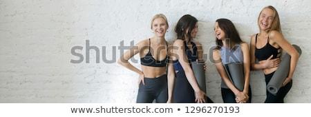 Fitt lány fitnessz oktató pózol mosolyog Stock fotó © ruslanshramko