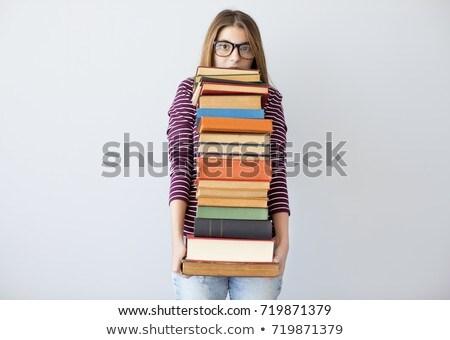 woman carrying books stock photo © kalozzolak