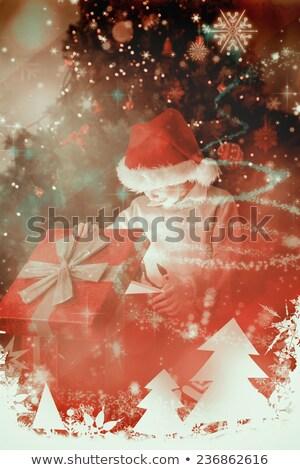 composite image of festive blonde opening a gift stock photo © wavebreak_media