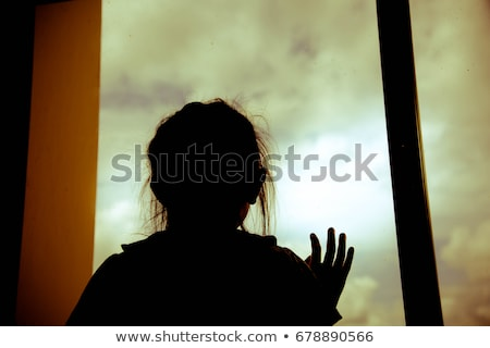 silhouette of a girl at the window stock photo © ruslanshramko