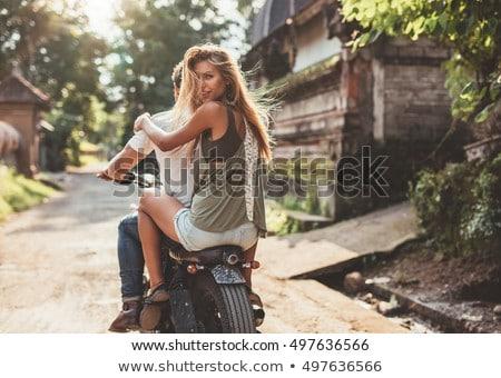 Uśmiechnięta kobieta posiedzenia chłopak piękna kobieta uśmiechnięty kamery Zdjęcia stock © wavebreak_media