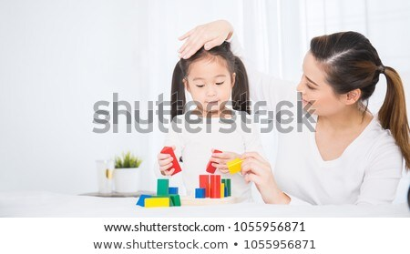 mother with her daughter at playground Stock photo © phbcz