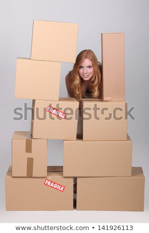 Woman stood by pile of cardboard boxes Stock photo © photography33