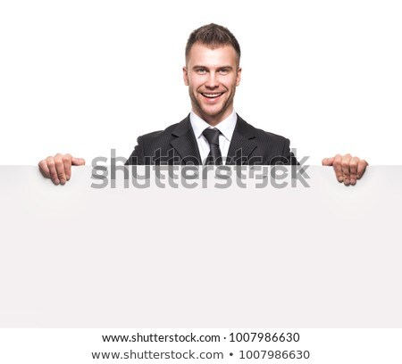 young man in suit holding a blank signboard Stock photo © nito