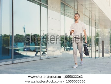 happy businessman holding briefcase walks to work Stock photo © feedough