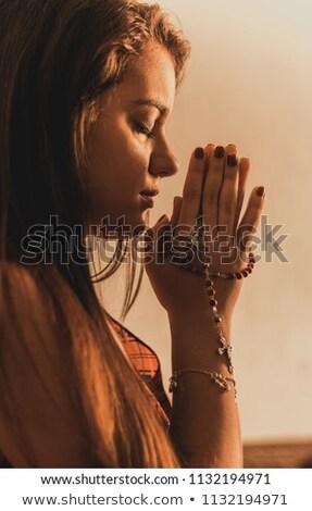Rezando joven gris brillante cruz Foto stock © ra2studio