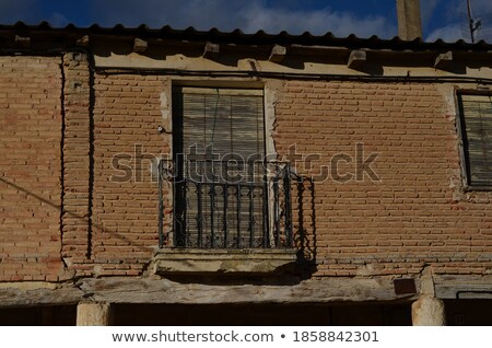 Brick house with balcony on second floor Stock photo © colematt