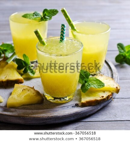 Pineapple cocktail with a slice of on wooden background and inscription in chalk . Tropical concept Stock photo © galitskaya