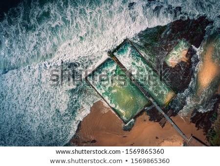 Tweeling antenne golven wassen rotsen Stockfoto © lovleah