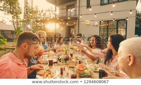 Feliz grande familia aire libre sentarse rock Foto stock © Lopolo