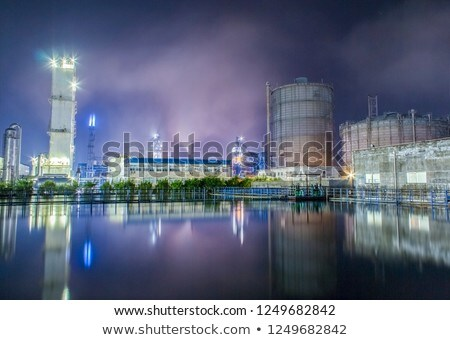 Scene with factory buildings producing smoke Stock photo © bluering
