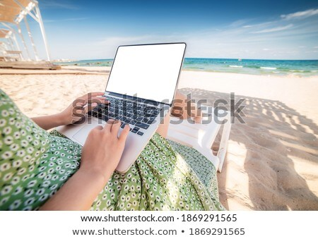 Computer mockup screen on wooden table against sea background. Stock photo © artjazz
