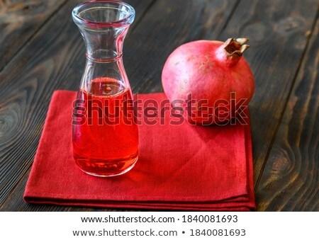 Glass jug of grenadine syrup Stock photo © Alex9500