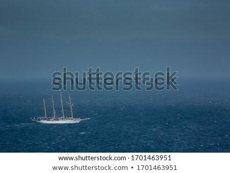 Jacht żeglarstwo ocean krajobraz górskich Zdjęcia stock © lightpoet