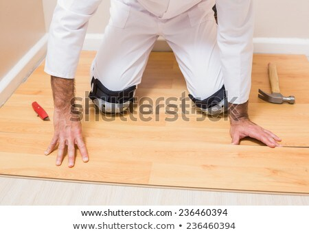 Man putting down underlay Stock photo © photography33