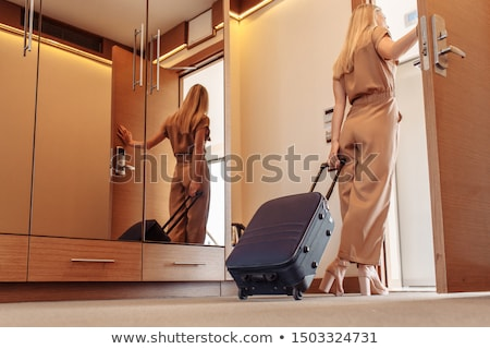 Woman leaving on a trip Stock photo © photography33