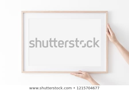 Woman hanging up wallpaper Stock photo © photography33