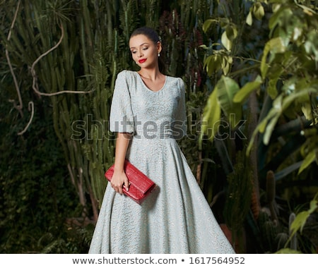Alluring woman holding luxury handbags Stock photo © konradbak
