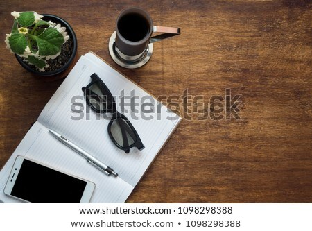 Notepad with pen coffee and flowers Stock photo © Lana_M