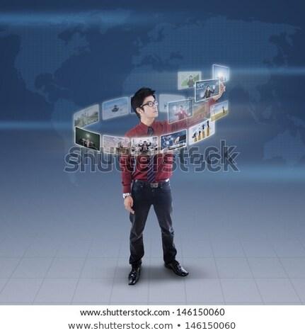 businesswoman with navigator on virtual screen Stock photo © dolgachov