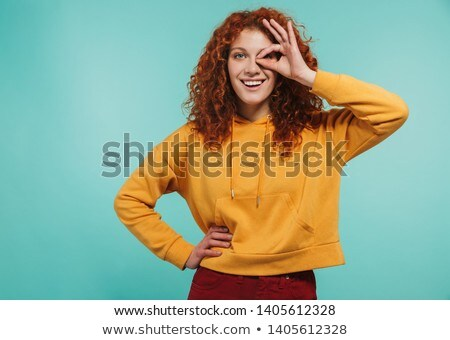 Foto stock: Photo Of Pretty Curly Woman 20s Smiling And Showing Ok Sign At C