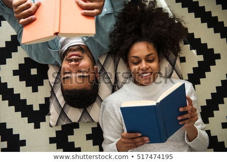happy couple reading book at home stock photo © dolgachov
