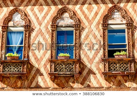 Traditional ancient gothic style window in Venice. Stock photo © ShustrikS