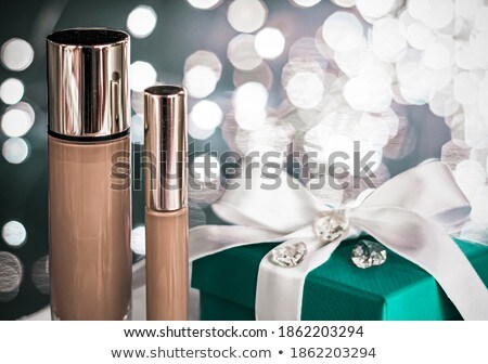 Holiday make-up foundation base, concealer and green gift box, l Stock photo © Anneleven