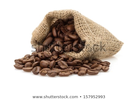 Spilled Coffee Beans With Green Leaves Isolated Stock photo © ThreeArt
