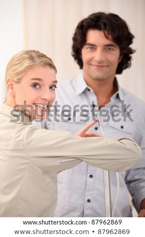 Woman pointing the end of a cable out to a man Stock photo © photography33