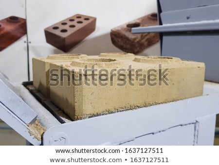Hand of a man making measures on a brick Stock photo © photography33