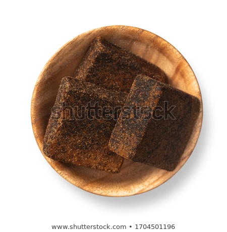 Stock photo: Brown sugar cubes in a bowl