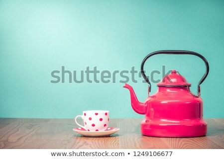 Photo of a tea mug and teapot with red tea Stock photo © Tatik22