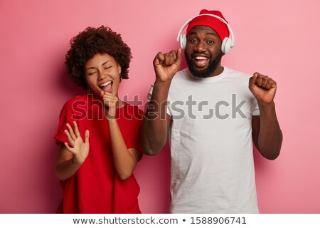 girl singing along to headphones stock photo © is2