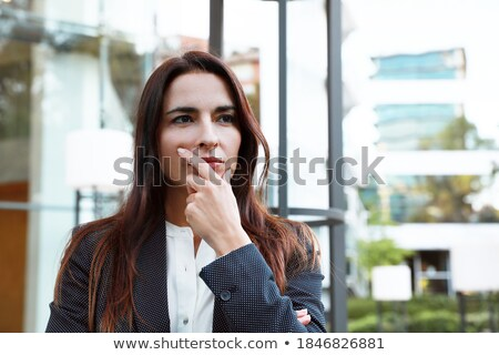 Stock photo: Portrait of young thoughtful office woman with brooding look in