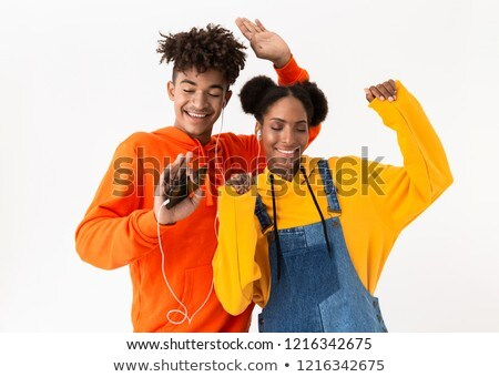 Photo of joyful african american brother and sister dancing and  Stock photo © deandrobot